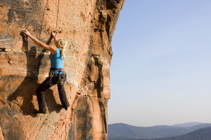 Young Woman Climbing