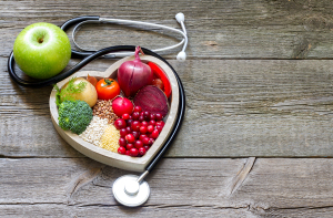 Healthy food in heart and cholesterol diet concept on vintage bo